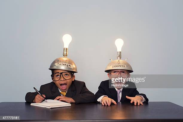 Two Young Boy Dressed in Suits and Thinking Caps
