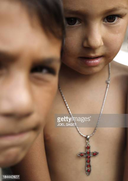 Two young boys belonging to the Roma community are pictured on August 7 2010 in a camp where their community sought refuge on August 2 2010 in...