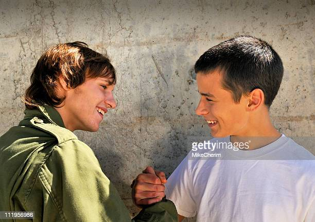 two young boys doing handshake