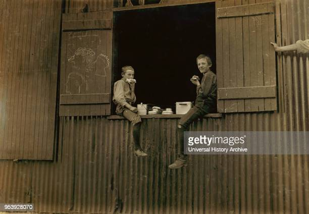 Two Young Boys eating Lunch, Economy Glass Works, Morgantown, West Virginia, USA, Lewis Hine for National Child Labor Committee, October 1908.