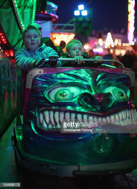 Two young boys emerge from the ghost train as they enjoy the thrills and fun of the traditional fair ground at the annual Goose Fair on October 6...