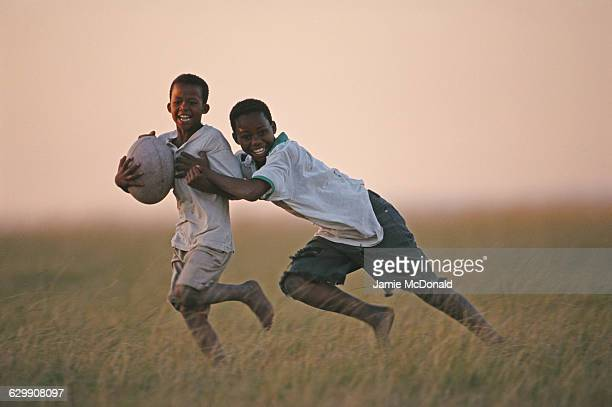 Two young boys enjoying playing rugby on 21 June 1999 in East London South Africa