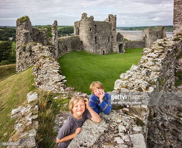 two young boys exploring a castle - castle stock pictures, royalty-free photos & images