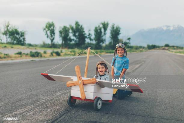 two young boys fly toy airplane - children only stock pictures, royalty-free photos & images
