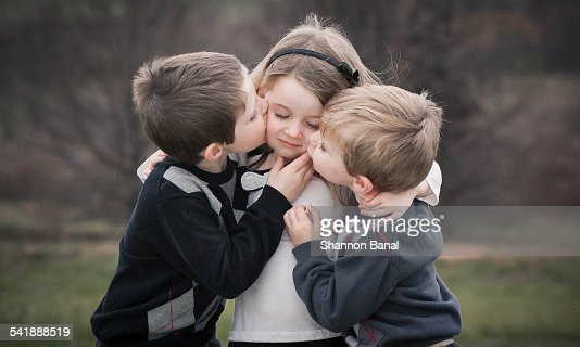 Two Young Boys Hug Kiss A Young Girl Stock Photo - Getty Images-6523