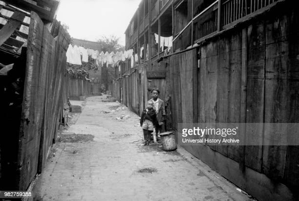 Two Young Boys in Alley Washington DC USA Carl Mydans for US Resettlement Administration July 1935
