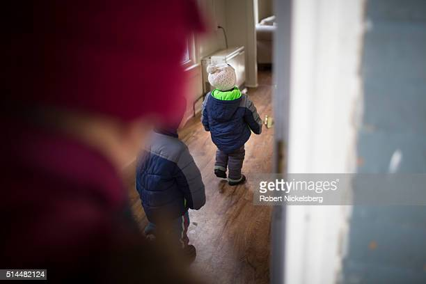 Two young boys look around an apartment as their parents look for a new home Burlington Vermont January 7 2016 Members of the extended Gurung family...