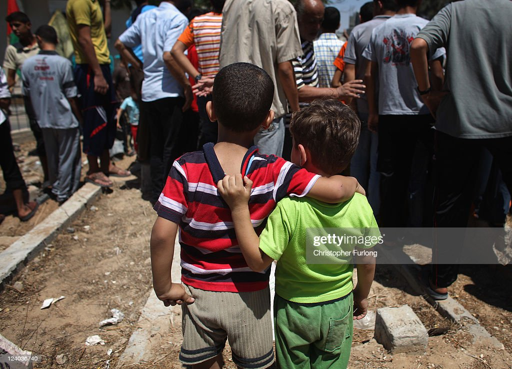 Two young boys look on as mourners attend the funeral of Palestinian Saad al-Majdalali who was shot by border guards after venturing too close to the Israeli fortifications on August 17, 2011 in Gaza City, Gaza. Palestinian President Mahmoud Abbas will formally submit the application for Palestinian statehood to the 66th United Nations General Assembly in New York on September 20th. The Palestinians and the Israelis are taking part in global diplomatic lobbying to win support for their differing positions on statehood. The Palestinian bid arises from two decades of on-and-off peace talks that have failed to produce a deal. The ultimate goal of the Palestinian Authority is to end Israeli occupation and to establish a sovereign and independent state on the 1967 borders with Jerusalem as its capital.