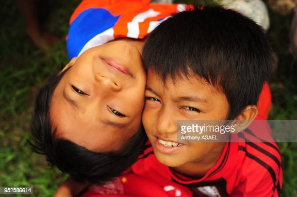 two young boys looking up Banda Aceh Sumatra Indonesia