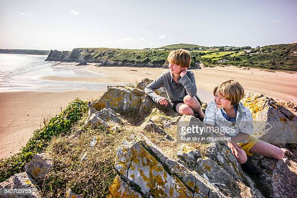 two young boys on a beach holiday - south wales stock pictures, royalty-free photos & images