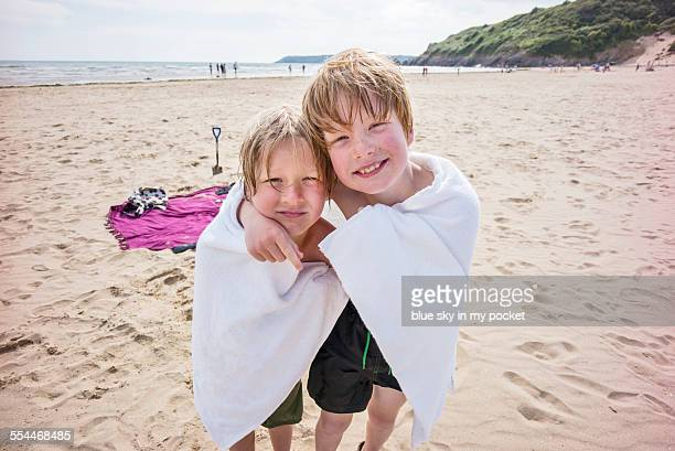 Two young boys on a beach holiday