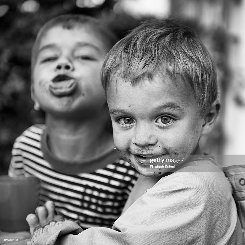 Two young boys, one smiling, one showing tongue : Stock Photo