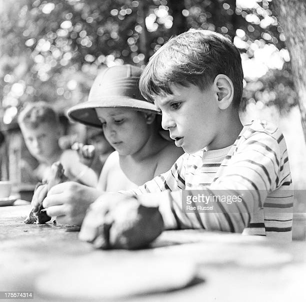 Two young boys play at Camp Henry the Henry Street Settlement's summer camp New York 1948 One of the boys is wearing a pith helmet