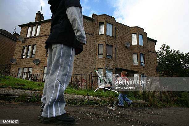 Two young boys play football in the street September 30 2008 in the Govan area of Glasgow Scotland A report by the Campaign to End Child Poverty...