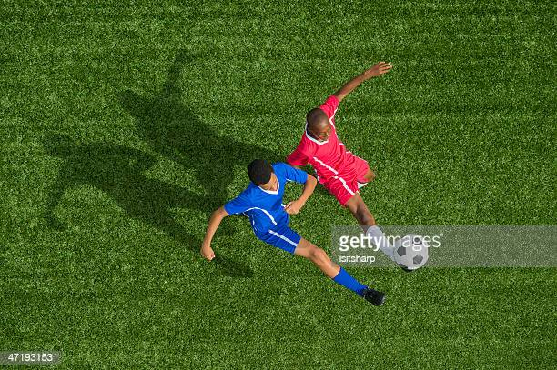 two young boys playing football - tackling stock pictures, royalty-free photos & images