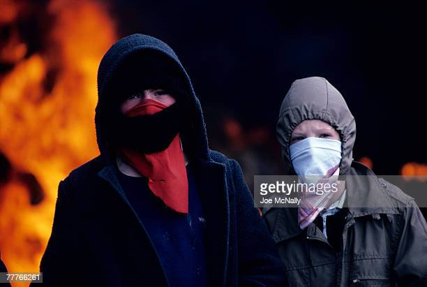 Two young boys pose in face masks in May of 1981 infront of a blazing fire in Northern Ireland. Bobby Sands, an active member of the Irish Republican...