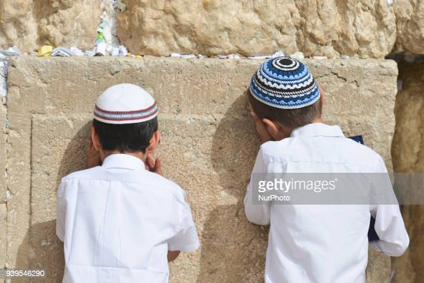 Two young boys pray at The Western Wall in the Old City of Jerusalem. Wednesday, 14 March 2018, in Jerusalem, Israel.