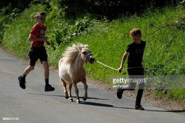 Two young boys walk their horse along a lane on the first day of the Appleby Horse Fair on June 7 2018 in Appleby EnglandThe fair is an annual...