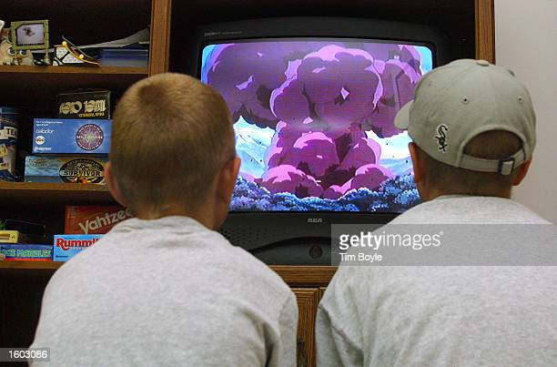 Two young boys watch a Pokemon video in their parent''s home July 20 2001 in Des Plaines IL home