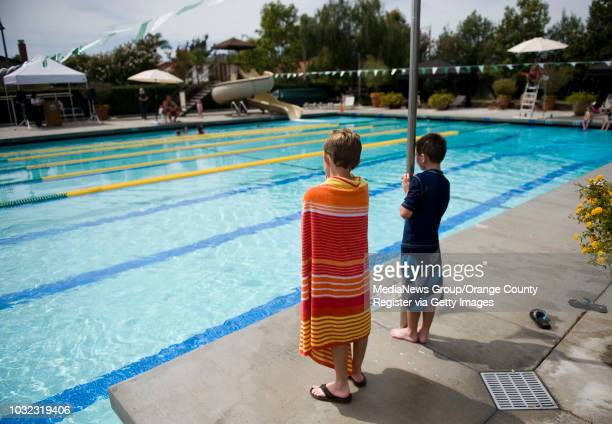 Two young boys watch as a mockdrowning occurs during Water Safety Day at the Sierra Recreation Center pool Thursday afternoon in Mission Viejo The...