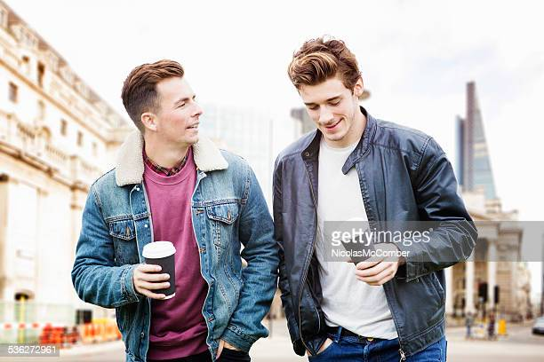 Two young British men walking downtown London Autumn clothing