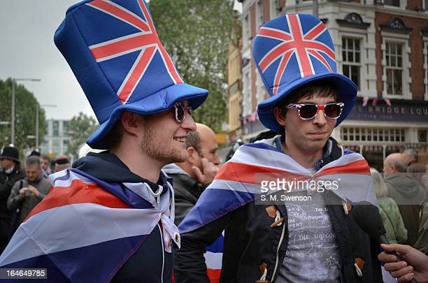 Two young British patriots being interviewed in the street on the afternoon of the Queen's Diamond Jubilee on June 3, 2012. They are covered in Union...