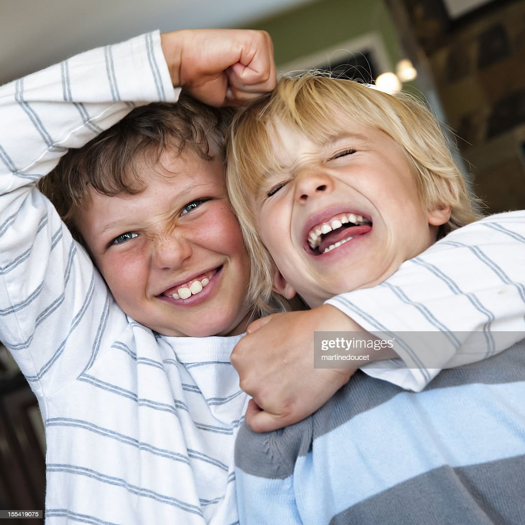 Two Young Brothers Fighting Stock Photo