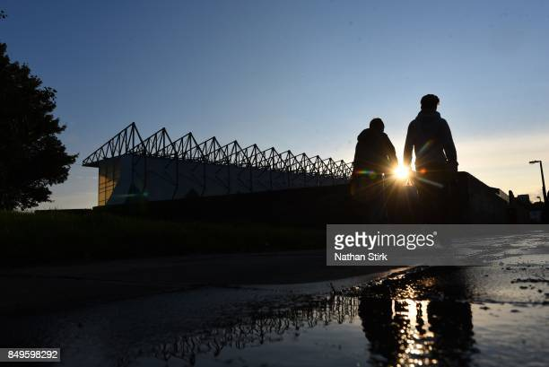 Two young Burnley fans walk to Turf Moor before the Carabao Cup Third Round match between Burnley and Leeds United at Turf Moor on September 19 2017...