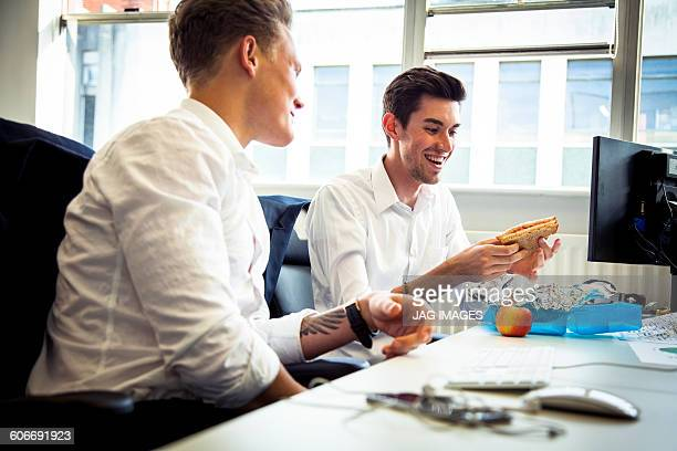 two young business men on their lunch break
