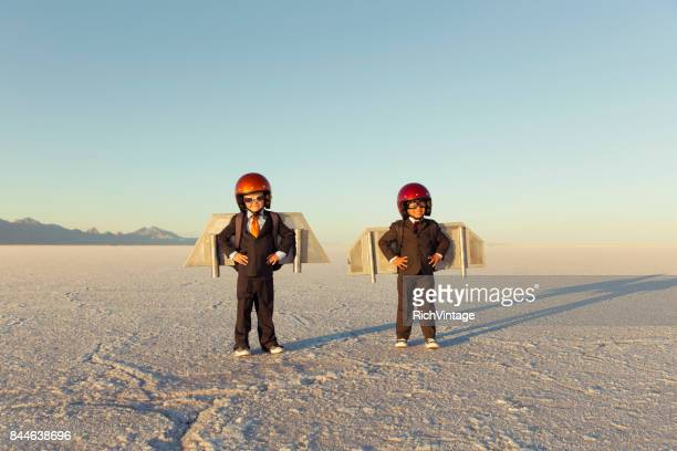 Two Young Businessman Wearing Jet Packs
