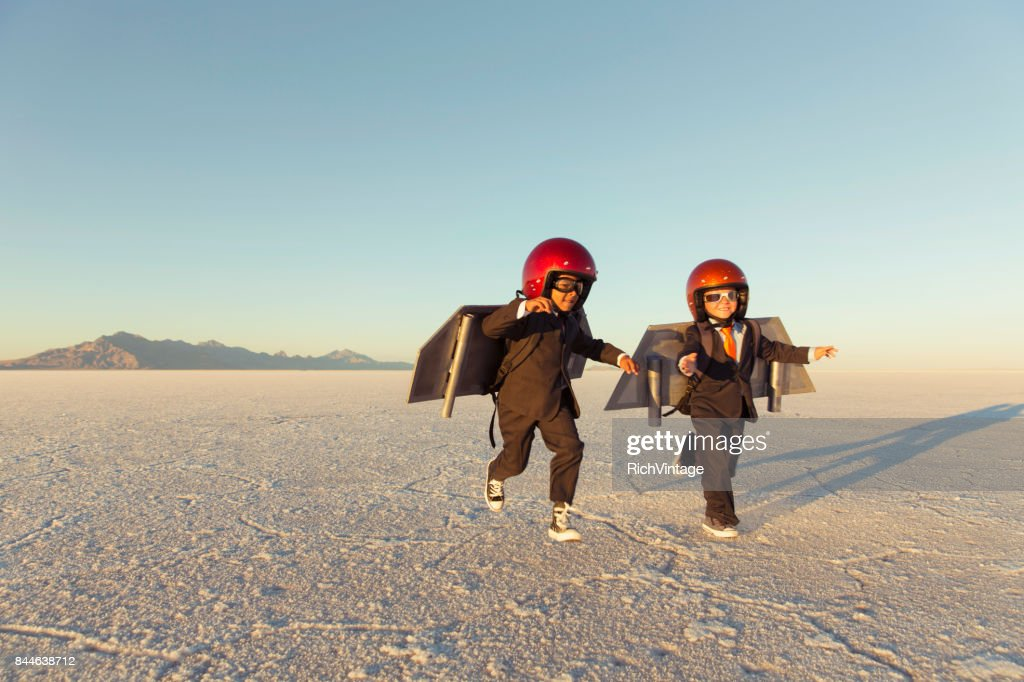 Two Young Businessman Wearing Jet Packs : Stock Photo
