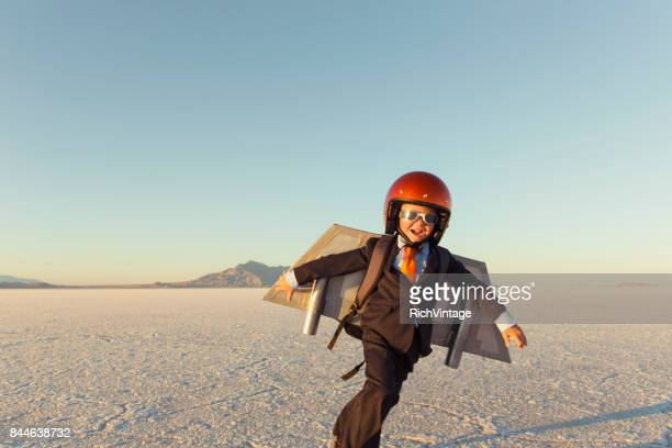 two young businessman wearing jet packs - strategy stock photos and pictures