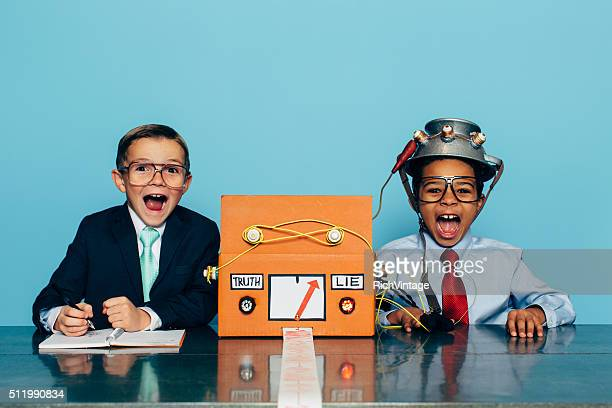 Two Young Businessman with Lie Detector