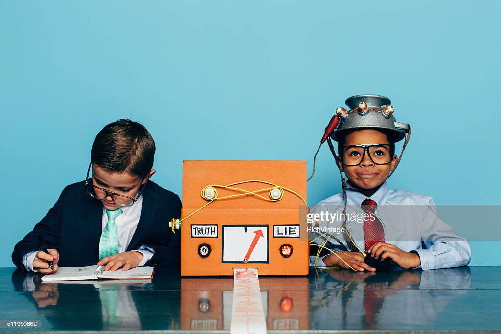 Two Young Businessman with Lie Detector : Stock Photo