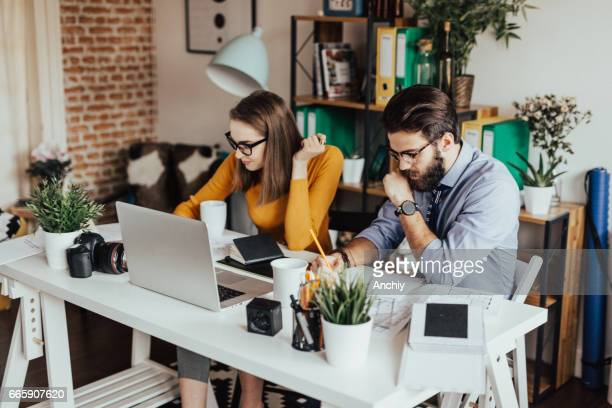two young businessman working together on a project - editorial stock pictures, royalty-free photos & images
