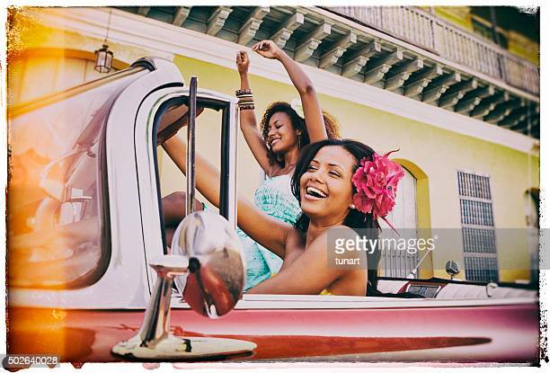 two young caribbean woman traveling in cuba - cuba stock pictures, royalty-free photos & images