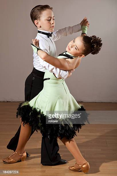 Two young children dancing the Waltz