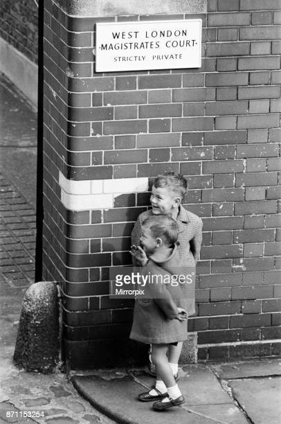 Two young children outside West London Magistrates Court John Duddy one of the men accused of the murder of three policemen in London is seen at West...