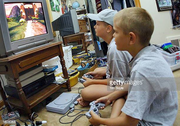 Two young children play a Play Station video game in their parent''s home July 20, 2001 in Des Plaines, IL.
