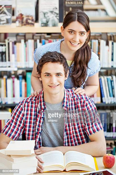 Two young college students at library