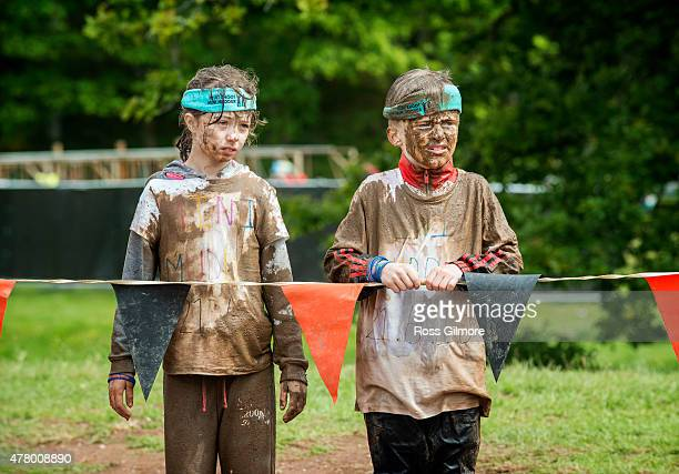 Two young Competitors take part in the Tough Mudder Scotland at Drumlanrig Castle on June 21 2015 in Thornhill England Tough Mudder is a 1012 mile...