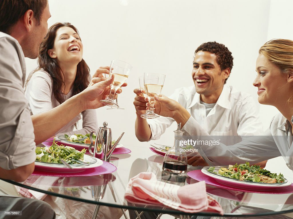 Two young couple toasting with wine at restaurant : Photo
