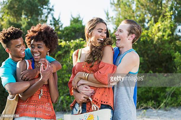 Two young couples having fun on summer day