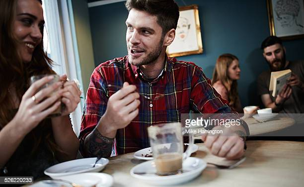 Two young couples in cafe