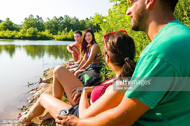 Two young couples sitting on canal bank, Delaware Canal State Park, New Hope, Pennsylvania, USA