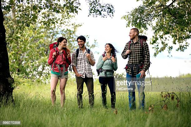 Two young couples talking about their weekend adventure