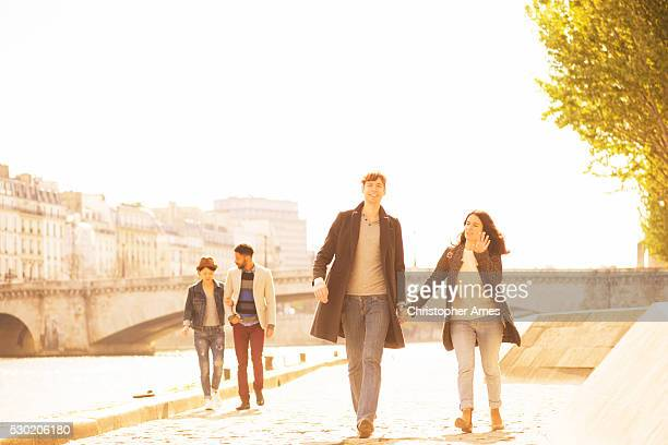 Two Young Couples Walking Along the Seine in Paris France