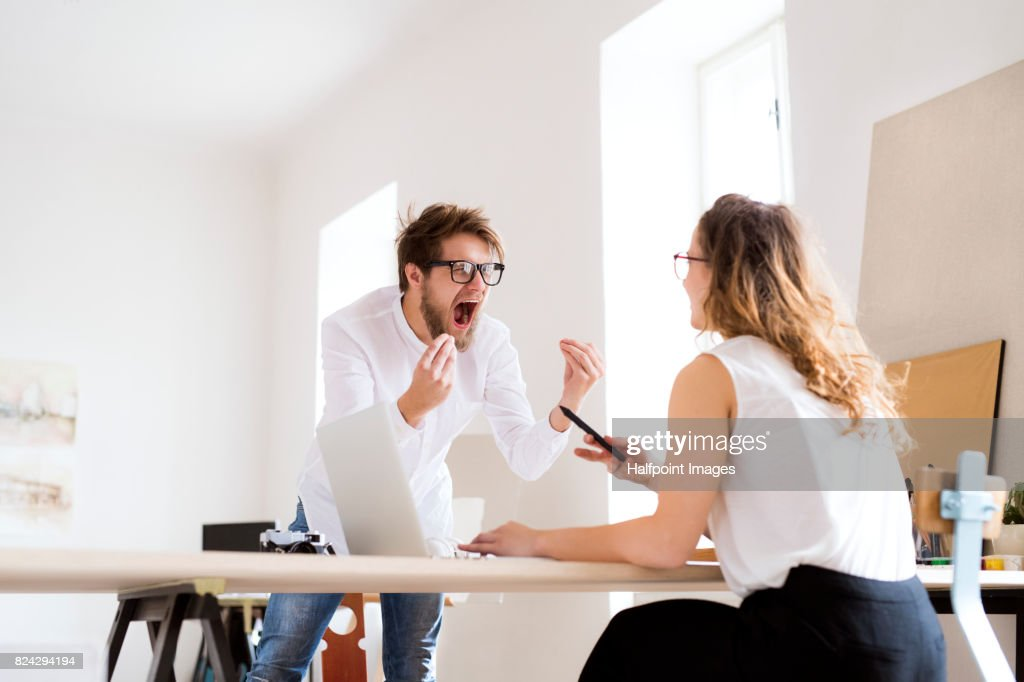 Two young designers having arguments. : Stock Photo