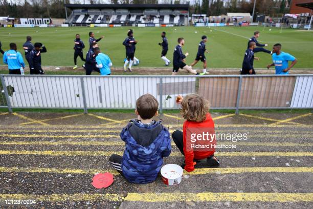 Two young fans enjoy some pre match food as the teams warm up prior tonthe Vanarama National League match between Maidenhead United and Stockport...