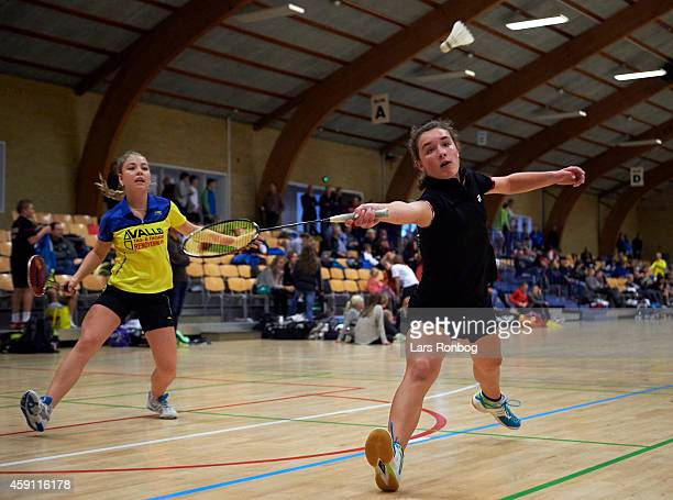 Two young female badminton players in action during the Yonex Denmark Junior Youth Badminton Tournament in Paarup Hallen on October 17 2014 in Paarup...